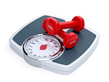 Weight scale with red dumbbells