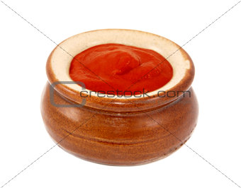 Tomato ketchup served in a small ceramic pot
