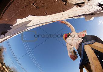 Aerosol Can Artist on Ladder