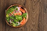 Salad with tomato, olives and spinach