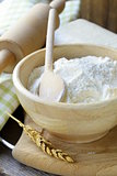 white flour in a wooden bowl - rustic style