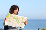 Beautiful tourist woman on vacation with a city map