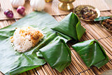 Nasi lemak wrapped with banana leaf.