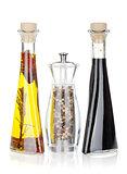 Olive oil, pepper shaker and vinegar
