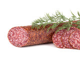 Slices italian salami sausage with dill