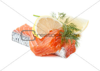 Two salmon pieces with lemon and dill