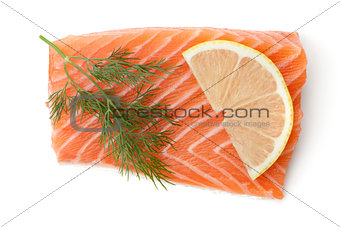 Fresh salmon piece with lemon slice and dill