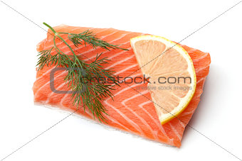 Fresh salmon steak with lemon slice and dill