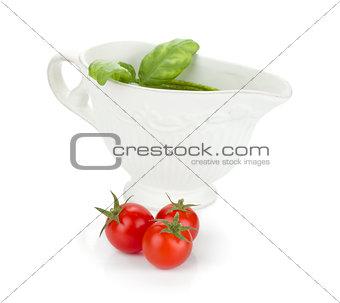 Three cherry tomatoes and pesto sauce