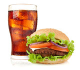 Glass of cola with ice and hamburger