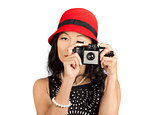 Cute pin up Asian lady taking photo with camera