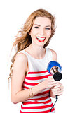 Happy female hairdresser holding hairdryer