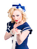 Strong sailor pin-up model pulling on tough rope