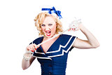 Pin up navy girl breaking naval rope with strength