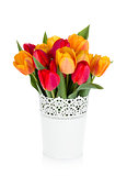 Red and orange tulips in flowerpot