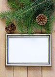 Christmas wooden background  gold frame and fir tree  branches