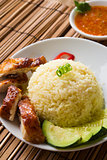 singapore hainan chicken rice with materials as background