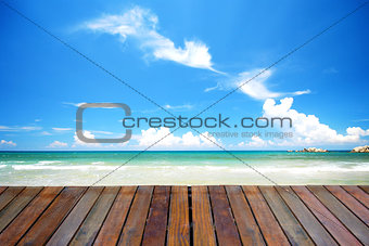 blue beach with empty plank woods, suitable for product placemen