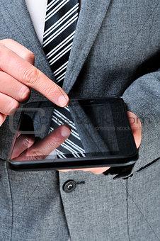 a businessman using a tablet computer