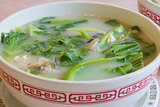 Fish Head Soup with Chinese Vegetable Closeup