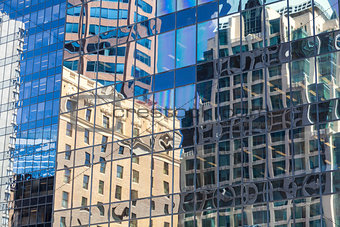 Old Building Reflections in Windows of Modern Office
