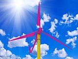 Colorful windmill against a bright sunny sky