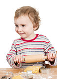 happy young child with rolling pin in white background