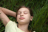 Girl relaxing on a meadow in nature