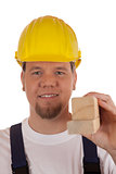 Construction worker holding wooden slats