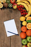 Shopping list and fresh fruits