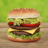 Double Cheeseburger with tomatoes and lettuce