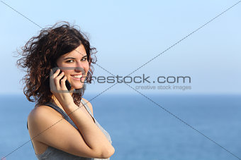 Attractive casual woman talking on the mobile phone