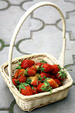 Fresh strawberries in white basket