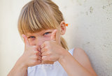 Young girl doing ok sign