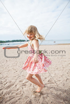 Smiling young girl having fun at beach