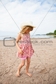 Young barefoot girl at beach