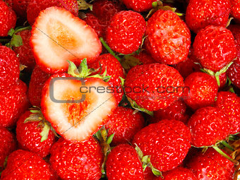 Many strawberries as a texture and sliced berry