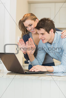 Man and woman use the webcam