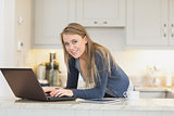 Happy woman using laptop