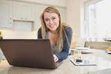 Woman smiling at the laptop
