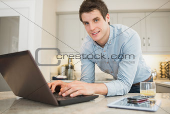 Man typing at the laptop