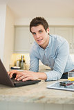 Man enjoying typing at the laptop
