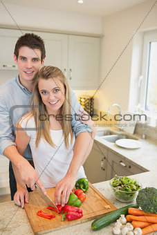 Couple working in the kitchen