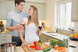 Couple enjoying drinking wine and cooking