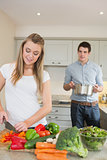 Young couple preparing dinner