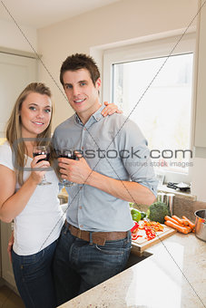 Couple drinking wine in the kitchen