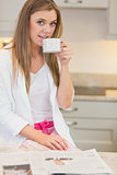Woman wearing  pyjamas and drinking a beverage