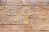 Wall with a carved relief: scenes of hunting and life. India