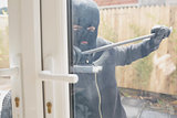 Burglar opening the door with a crowbar