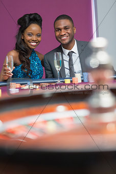 Couple sitting at roulette table